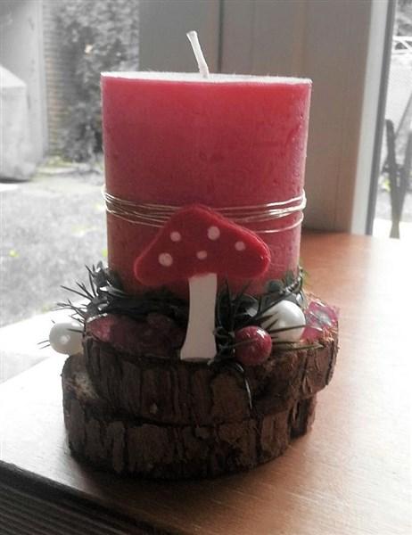 Kerzengesteck auf Holzscheiben