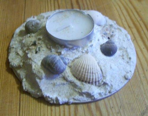Teelichthalter aus Sand und Muscheln